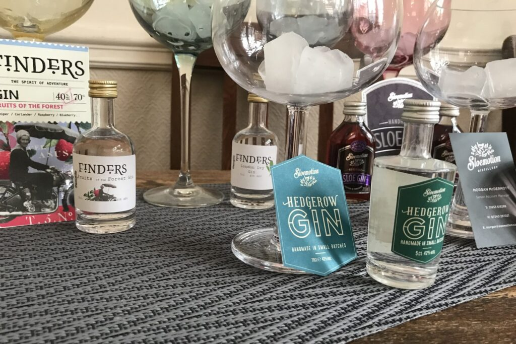 Bottles of Slowmotion Gin's on table with glasses
